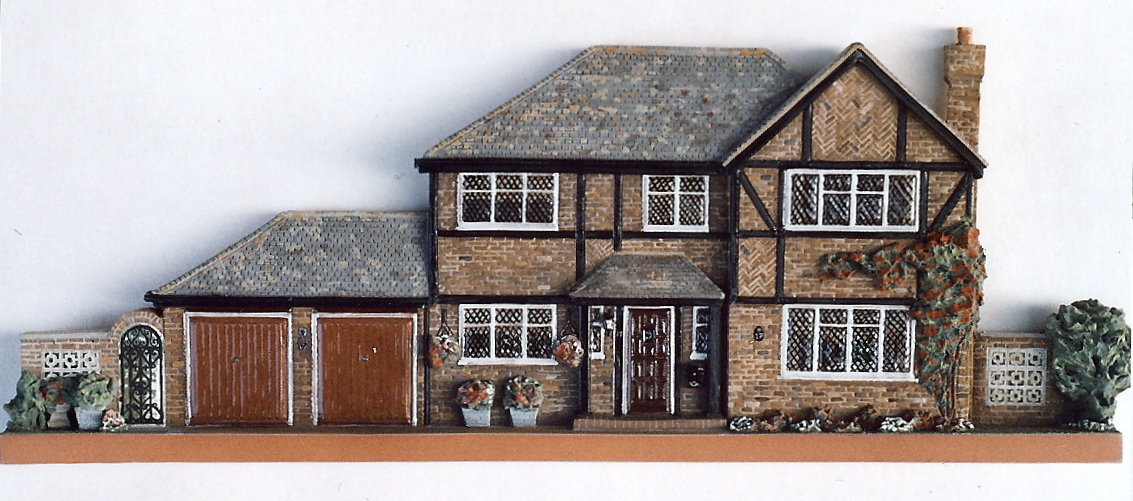 Architectural reliefs house portraits daughters of earth for Modern tudor house