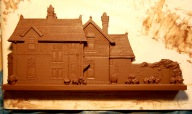 8. Clay portrait East front raw